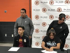 SJHS Seniors Julio Jauregui and Jessica Diaz sign letters of intent for athletic scholarships.