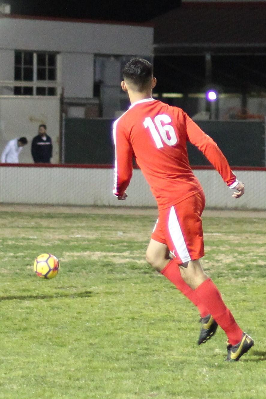 Christian Fernandez running down the field