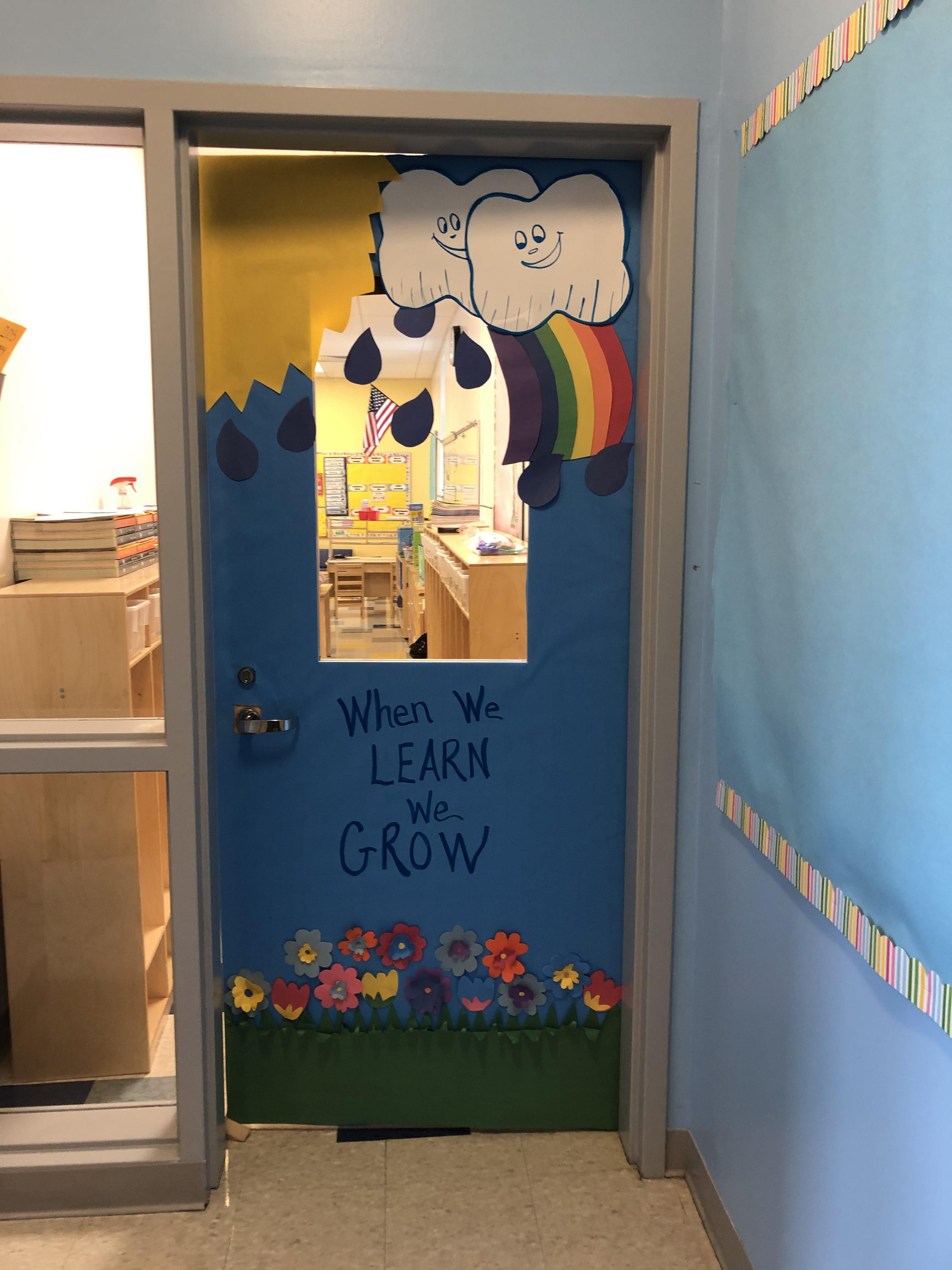 'When we learn we grow' weather decorated classroom door