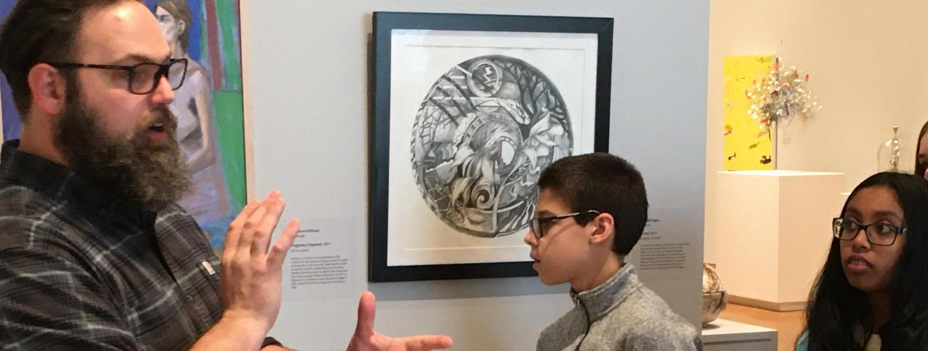Artist and FR 1999 Alumni Christopher Ruane chats with FRMS art students as they explore his photography exhibit as the Westmoreland Museum of American Art.