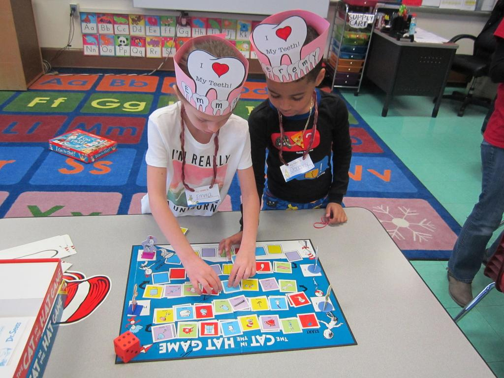 two children playing the cat in the hat game