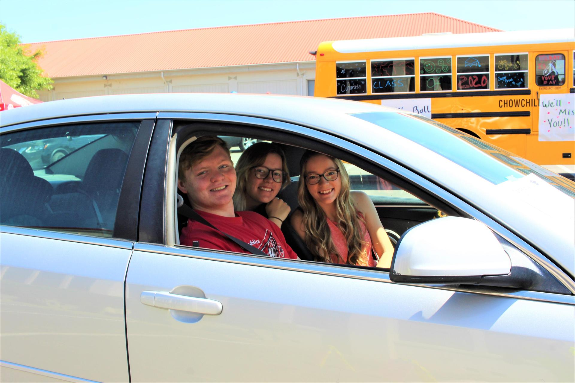 Zachary Ellison and Emma McCluskey riding with Samantha McCluskey driving
