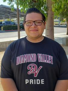 Francisco Zaragoza standing in front of the Diamond Valley parking lot.