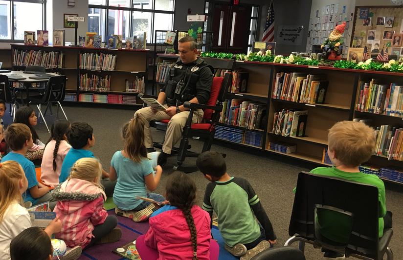 Deputy Wassuf reading to students
