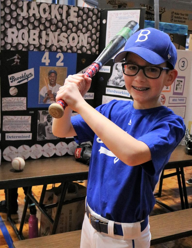 "Photo of Wilson 5th grader as Jackie Robinson at annual ""Wax Museum"" event."