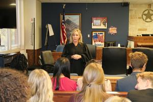 Judge Robins talking to students
