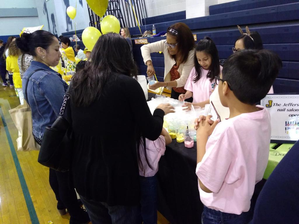 kids and moms making colored slime