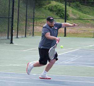 Picture of Parker Maloney playing tennis