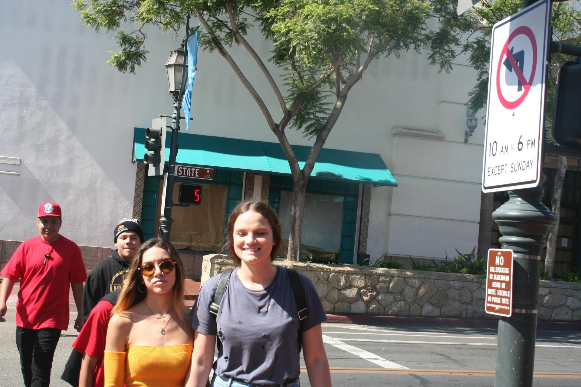 Walking across the street in downtown Santa Barbara