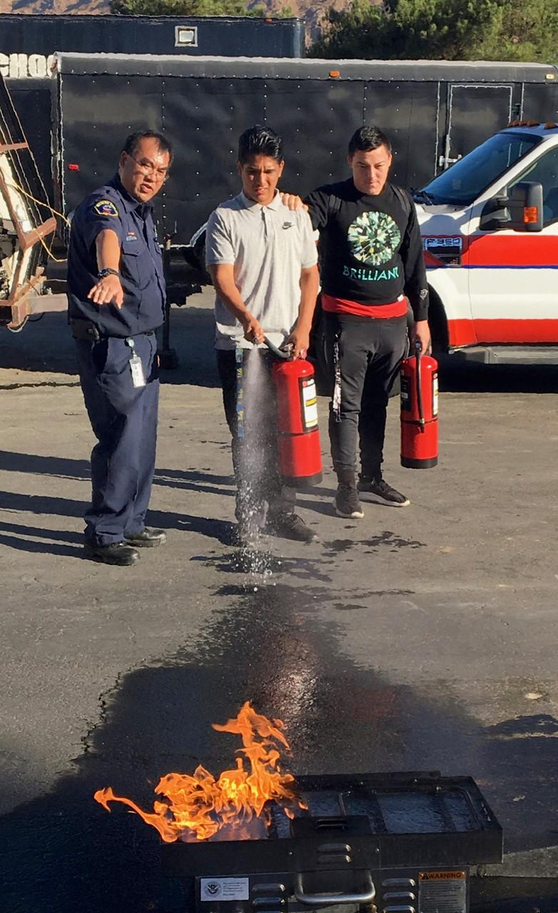 Students extinguishing fire