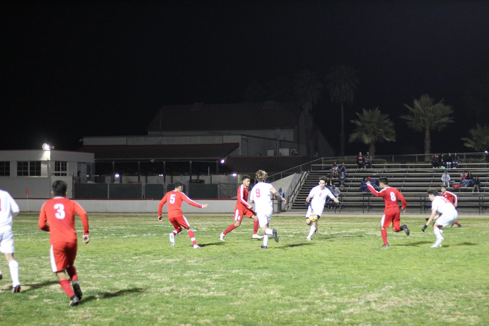 Antonio Ochoa, Edgar Campos, and Favian Casillas going after the ball