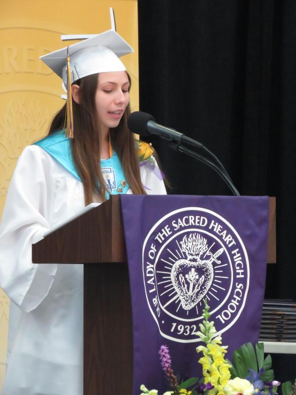 photo of OLSH valedictorian making speech at graduation