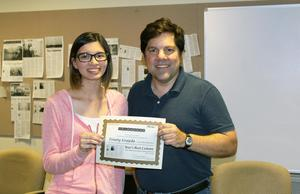 Trinity Grajeda accepting her award from David Goehner of the ESD 105 and the Yakima Herald's