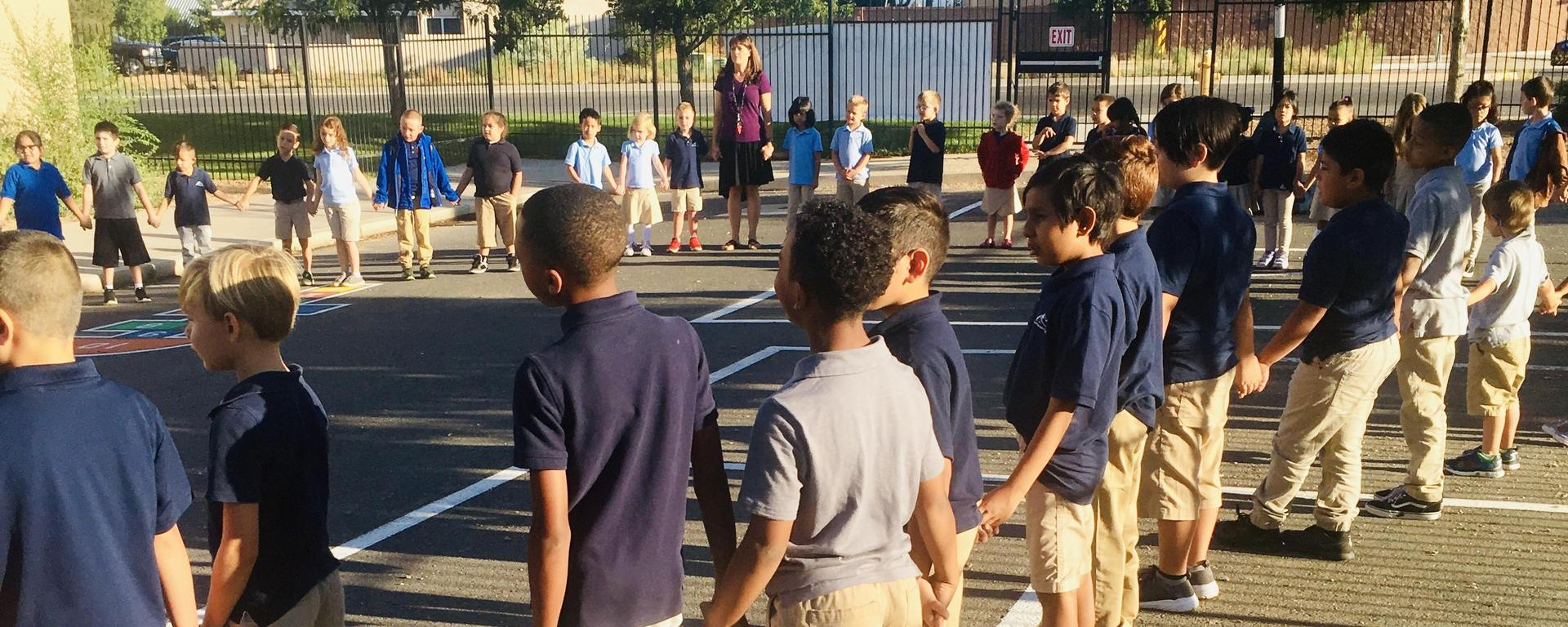 Students stand in a circle for Morning Circle