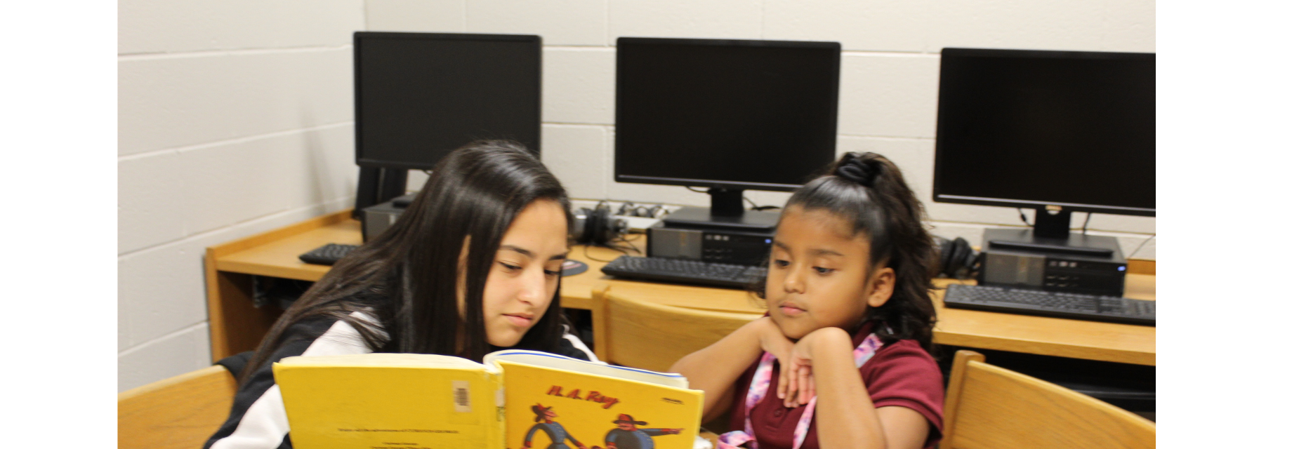 Students reading a book