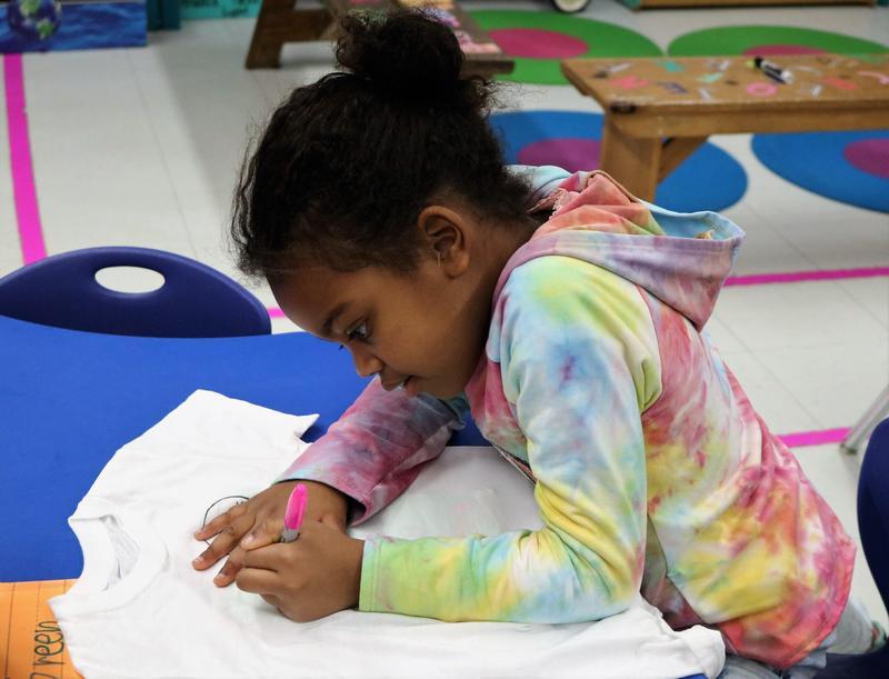 Photo of Tamaques 1st grader working on 100th Day of School activity.