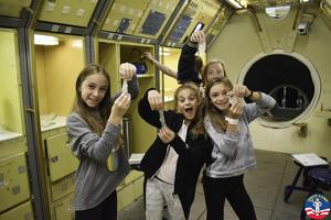 Edison 7th graders (L-R) Chloe Golub, Avery Brooks, Ava Braddock, and Emma Epstein enjoy learning about space travel during a 5-day, dynamic STEM field trip that included 3 days at the U.S. Space and Rocket Center in Huntsville, Alabama.