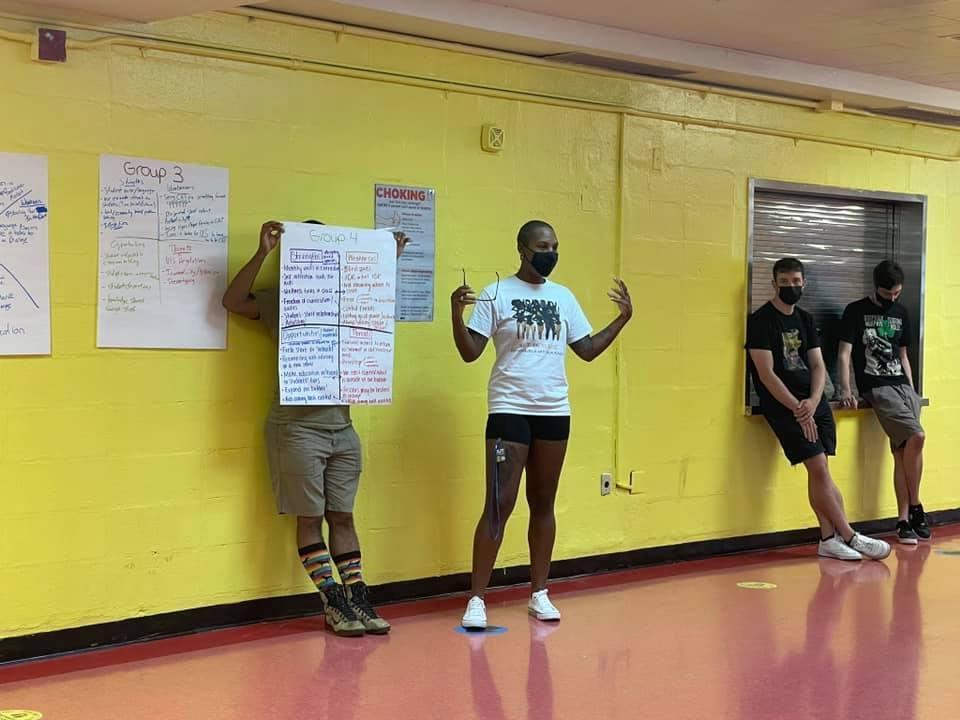 2 teachers presenting a poster