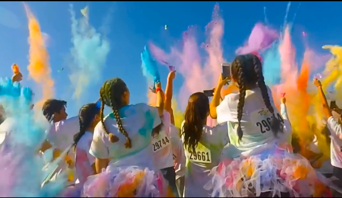 group of people with multi-colored powder cloud