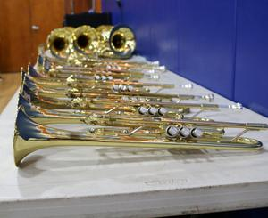 Photo of brass instruments on table.