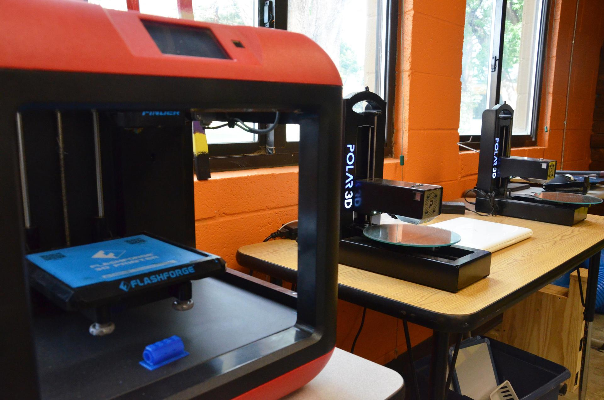 Close-up of 3D printers in the makerspace