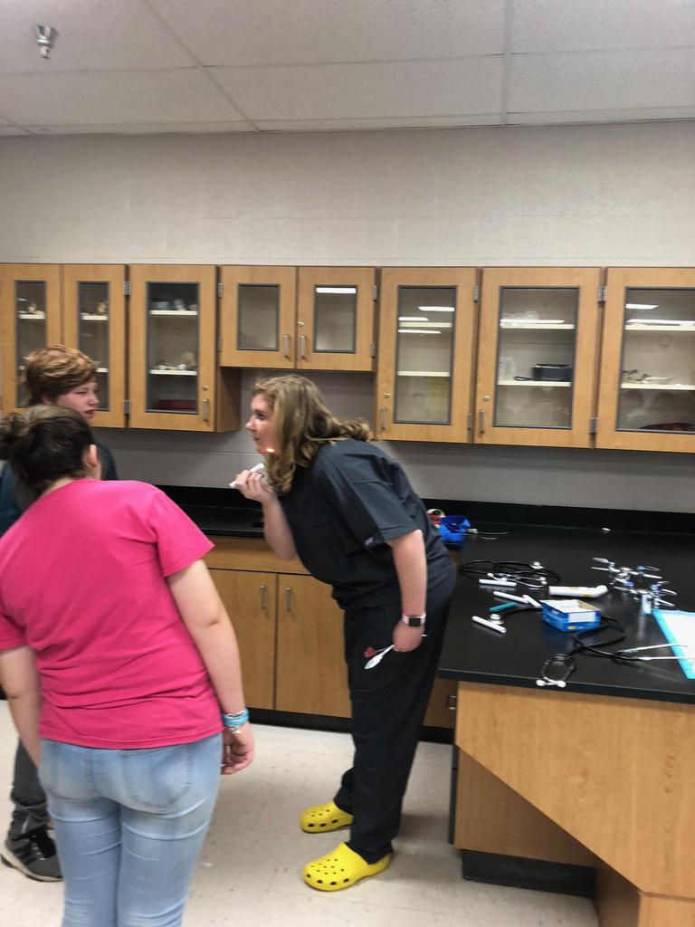 Health science students teach how to check for vital signs