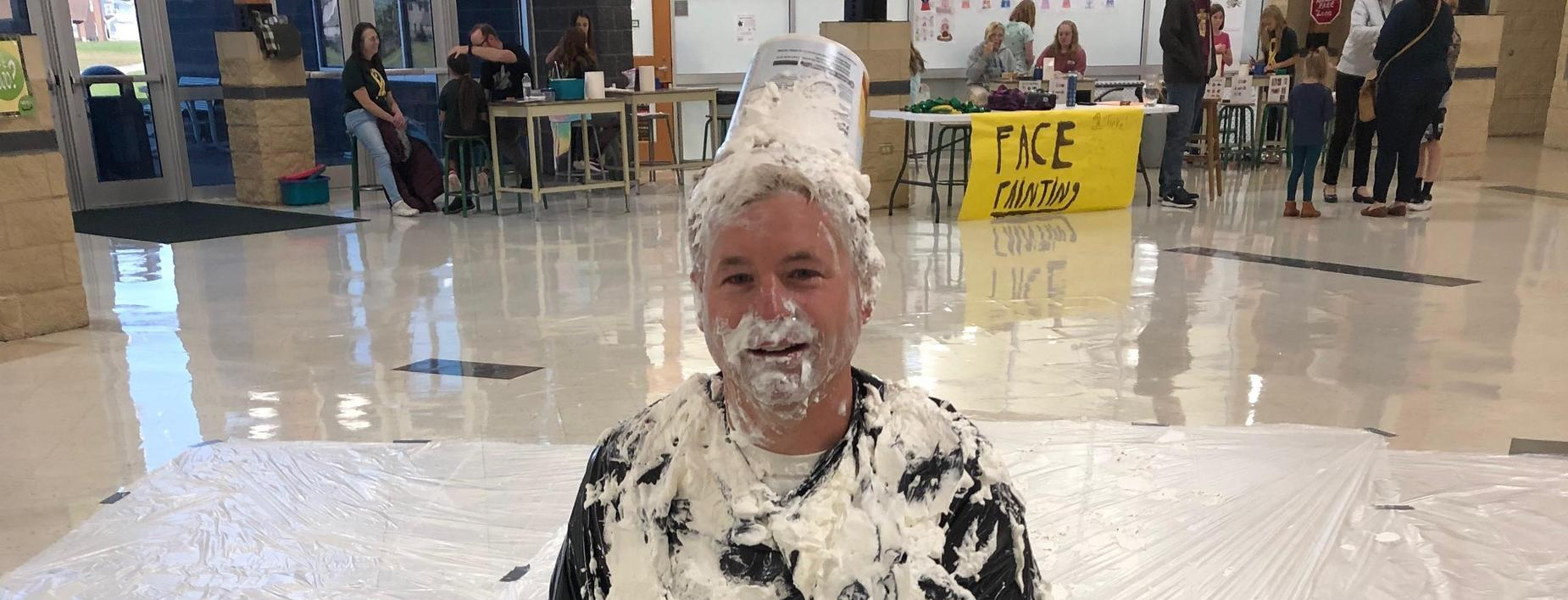 Mr Larson took a few pies to the face