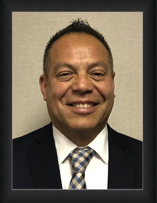 Trustee Rigo Espinoza
