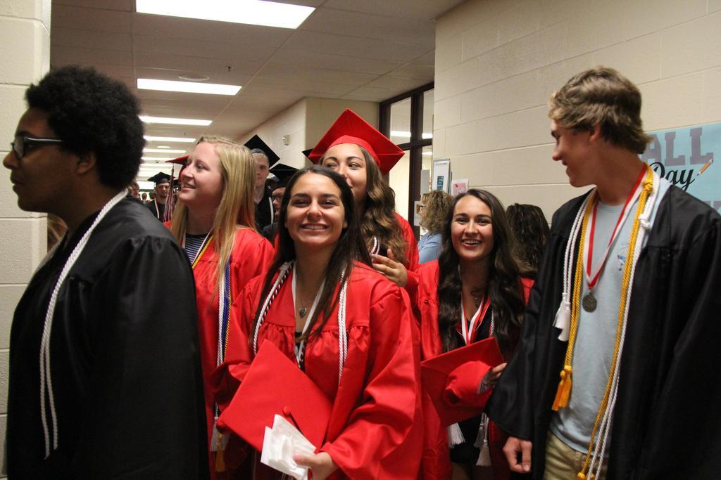 Graduating students in a school hallway