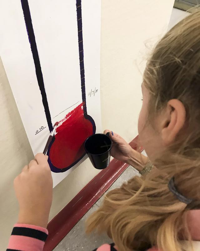 Female student painting in the counter indicator.