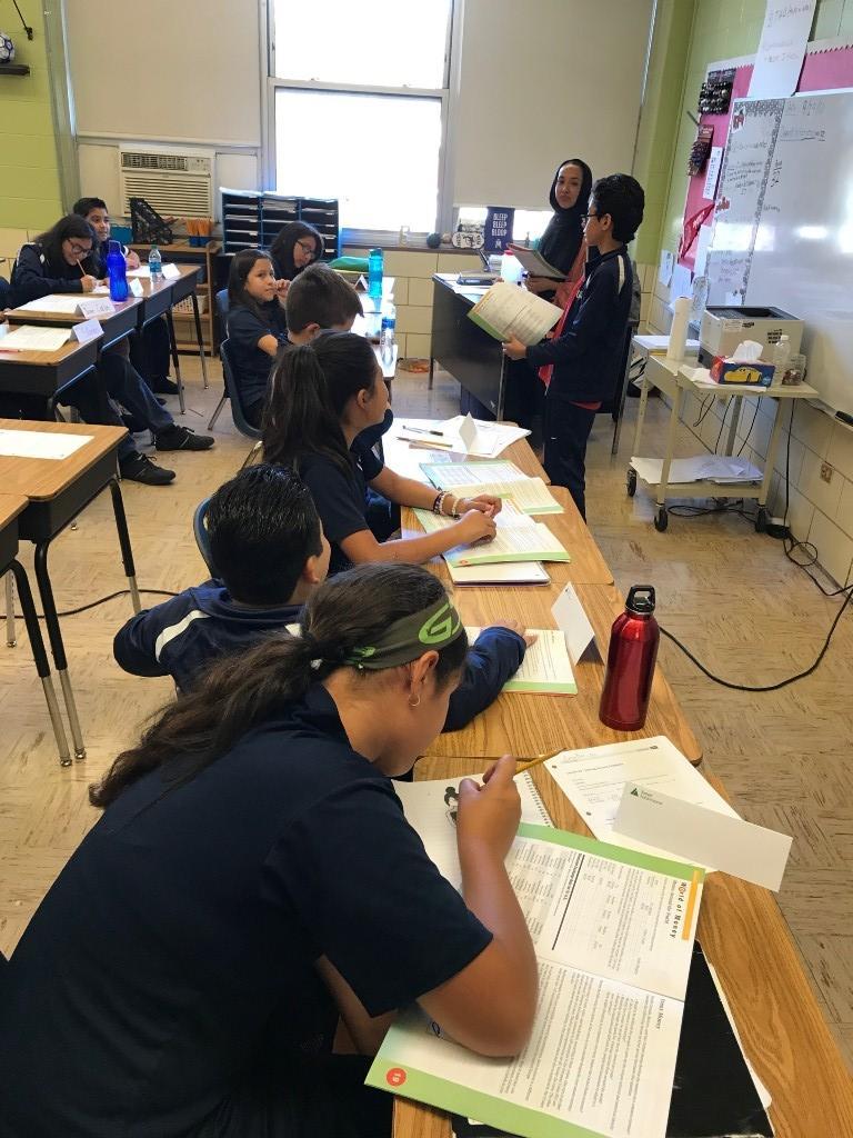 Student sharing at front of 6th grade