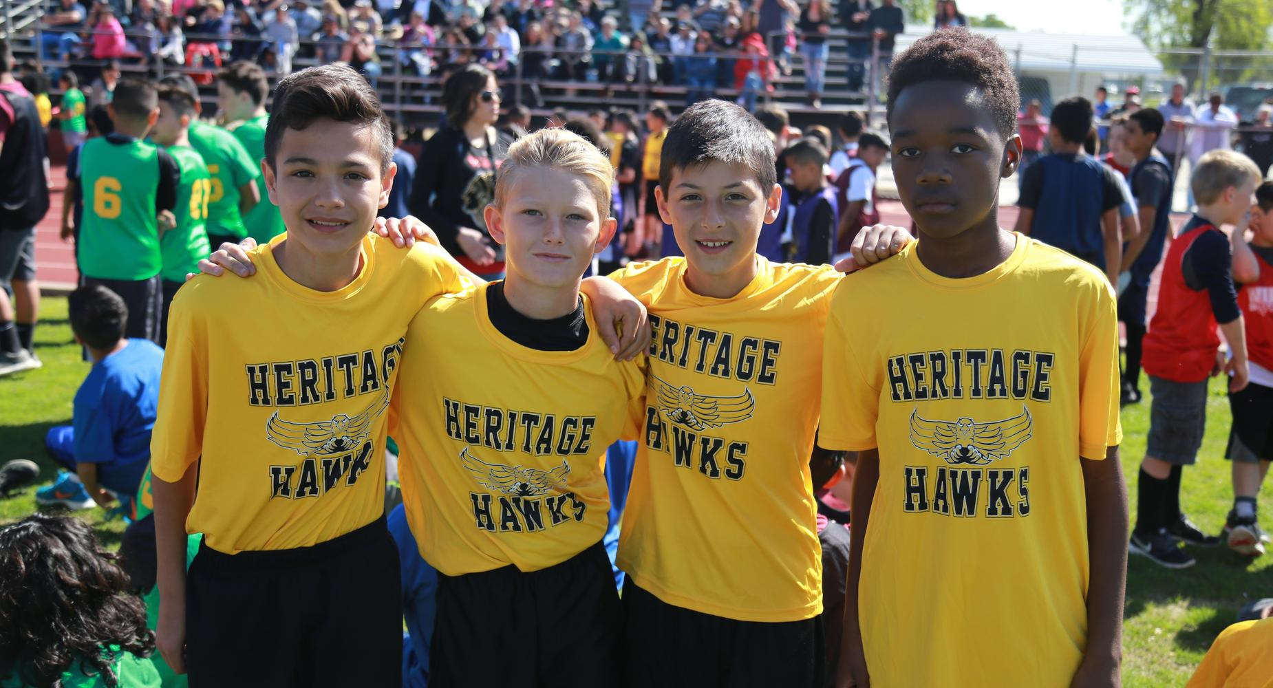 Group of 4 boys at track meet