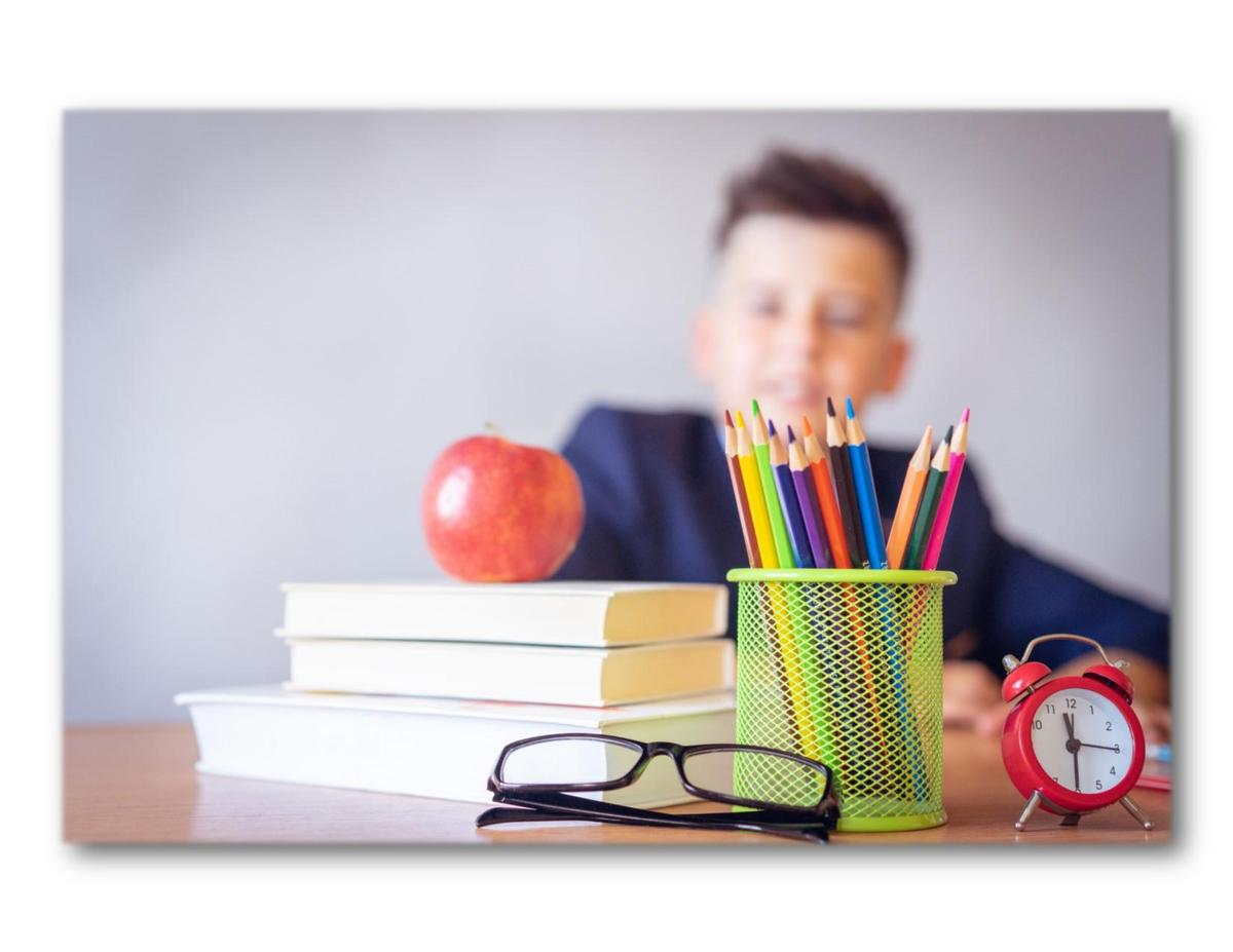 boy with school supplies