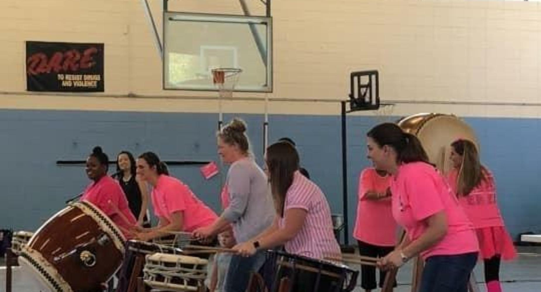 teachers playing taiko drums