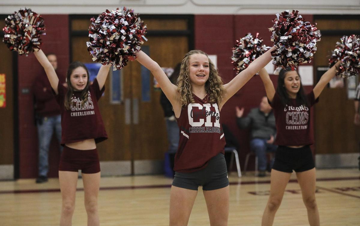 Middle School cheerleaders cheering
