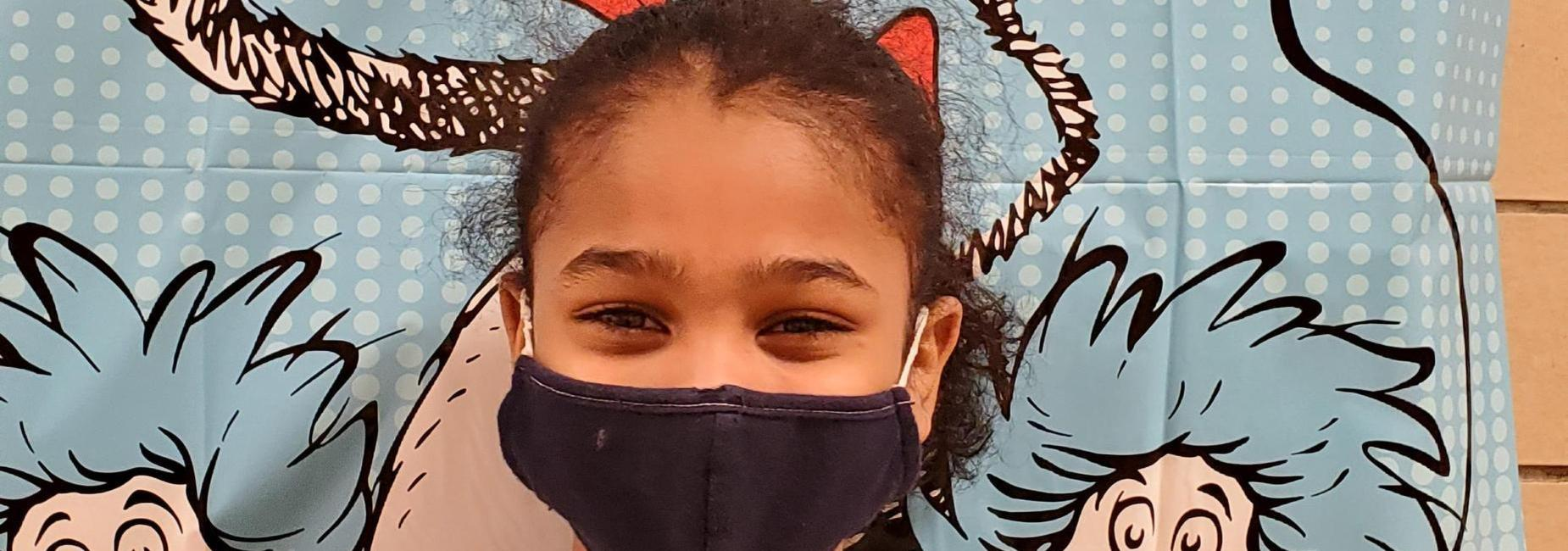 Girl smiling with mask