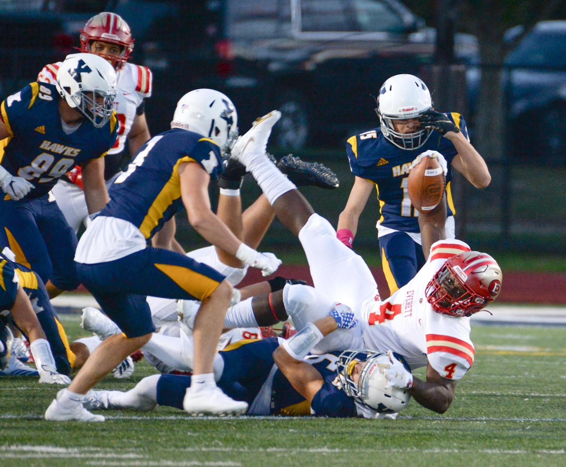 Football action, Tide player in a pile of Xaverian defenders