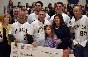 Representatives of the Pittsburgh Pirates, Pirates Charities, Chevron and The Grable Foundation present teacher Joe Joswiak and his family (center)with a $1,000 check to benefit the health & physical education program at Mars Area Middle School. The prize was awarded as part of Joswiak's selection as a 2020 All-Star Teacher.