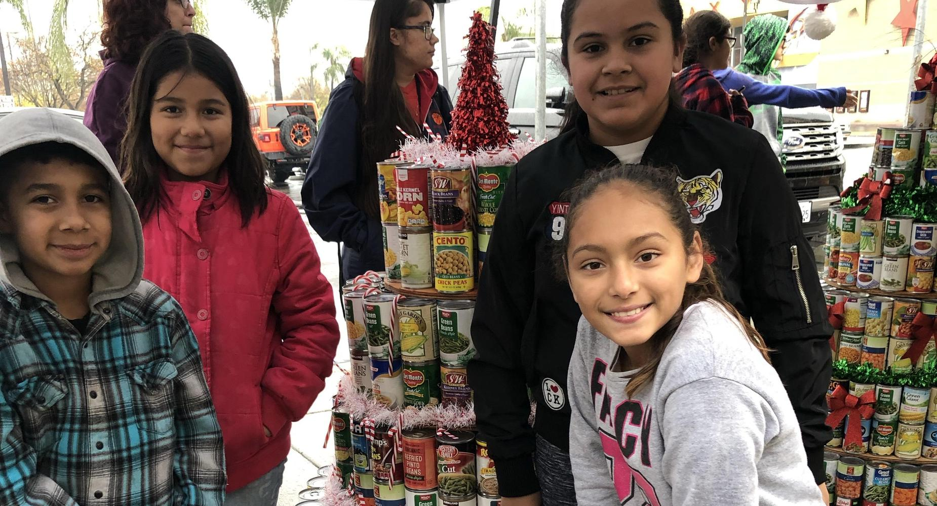 Some CHOICES students make a canned food Christmas Tree.