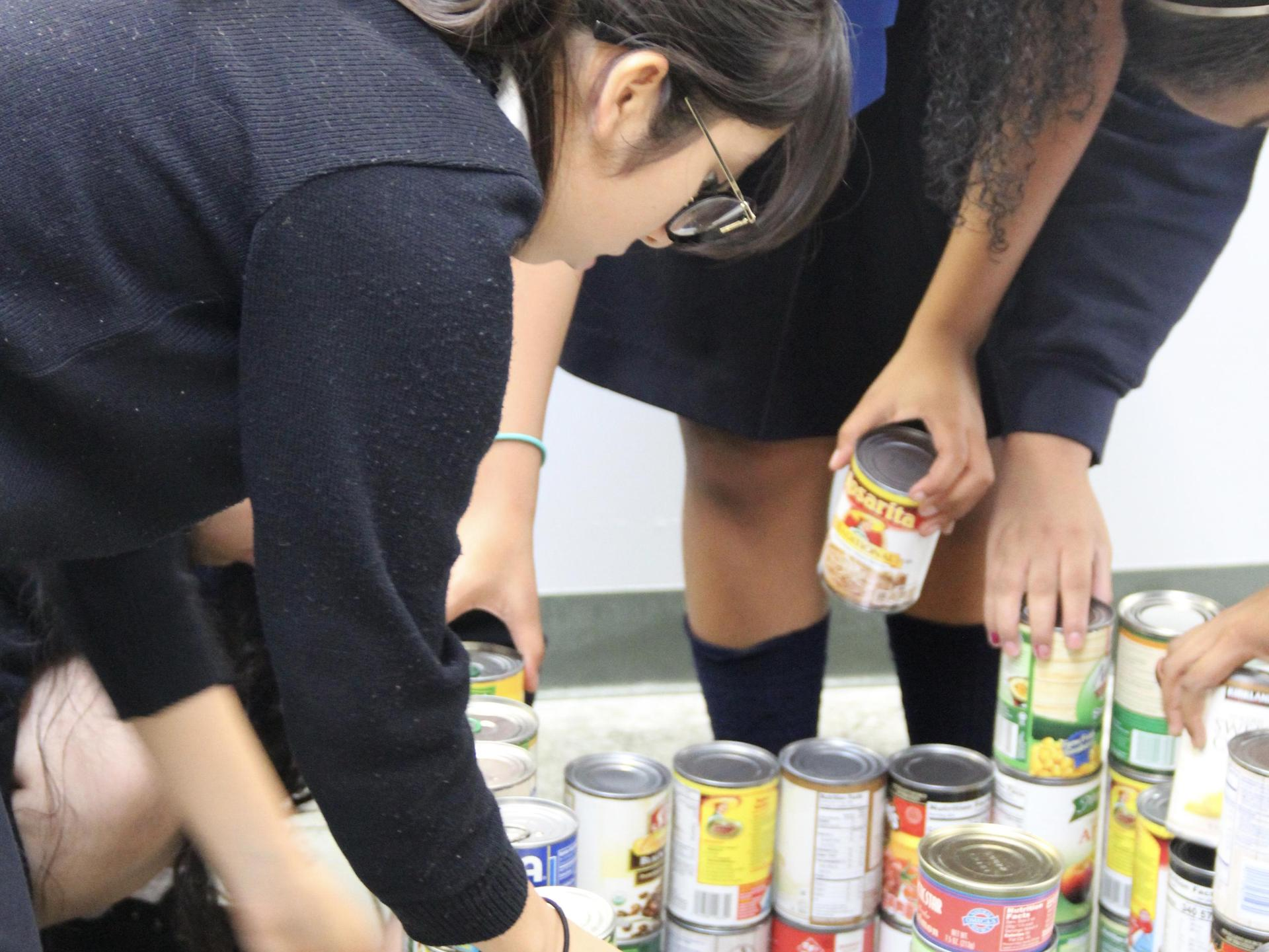 students sorting cans