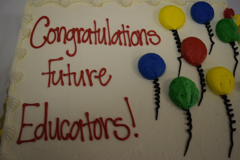 Cake with message of congratulations to the future educators