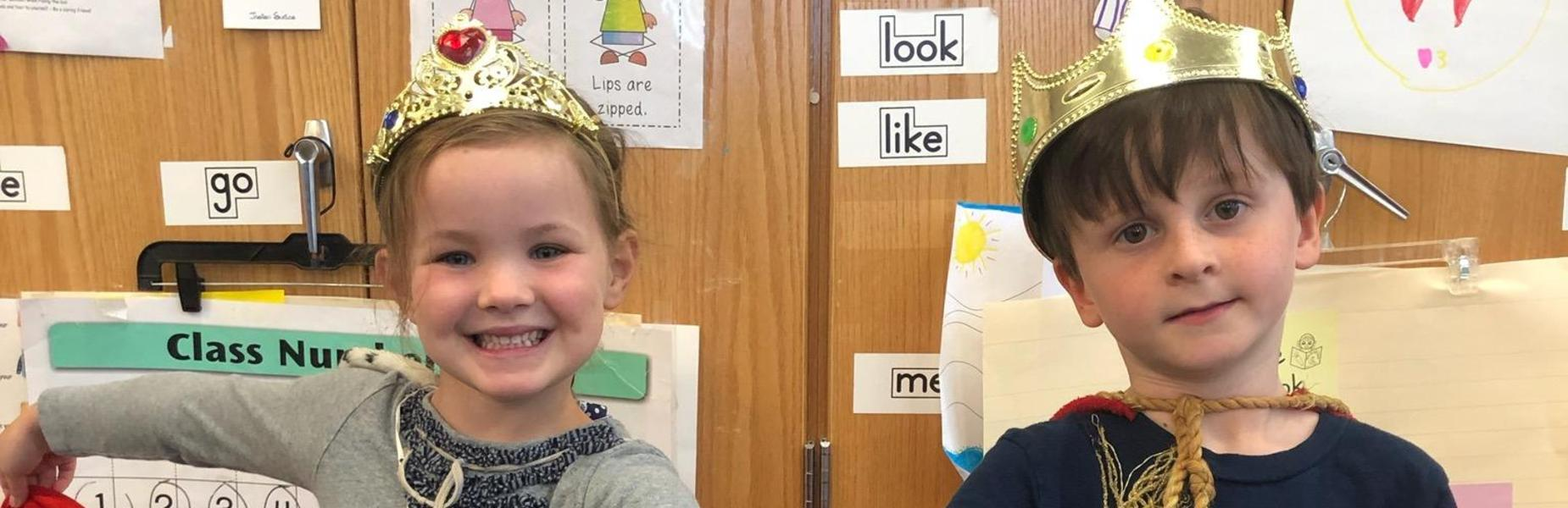 Photo of two Lincoln School kindergartners dressed as king and queen.