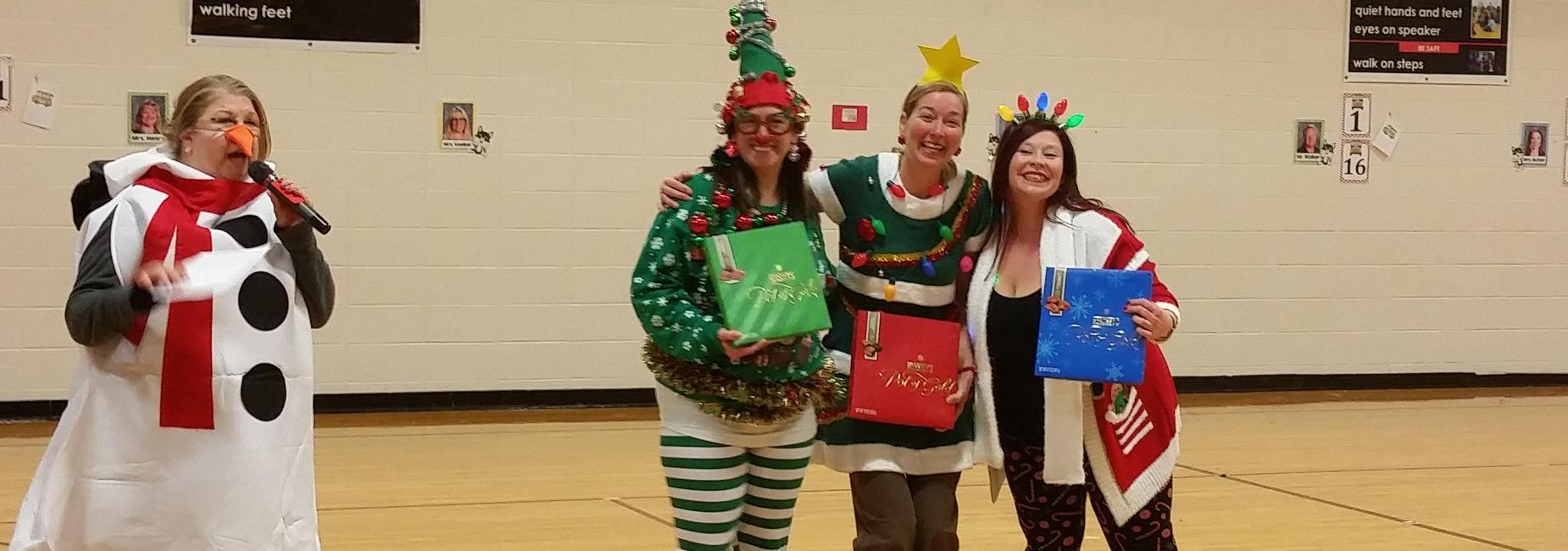 Teachers celebrating their holiday fashion show win.