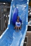 Fine Arts Academy teachers Amy Brown and Christi Eldridge take to the slides of Splash Dayz during the Education  Foundation's BRRRewer Bear Plunge on Jan. 27. The foundation raised nearly $6,000!