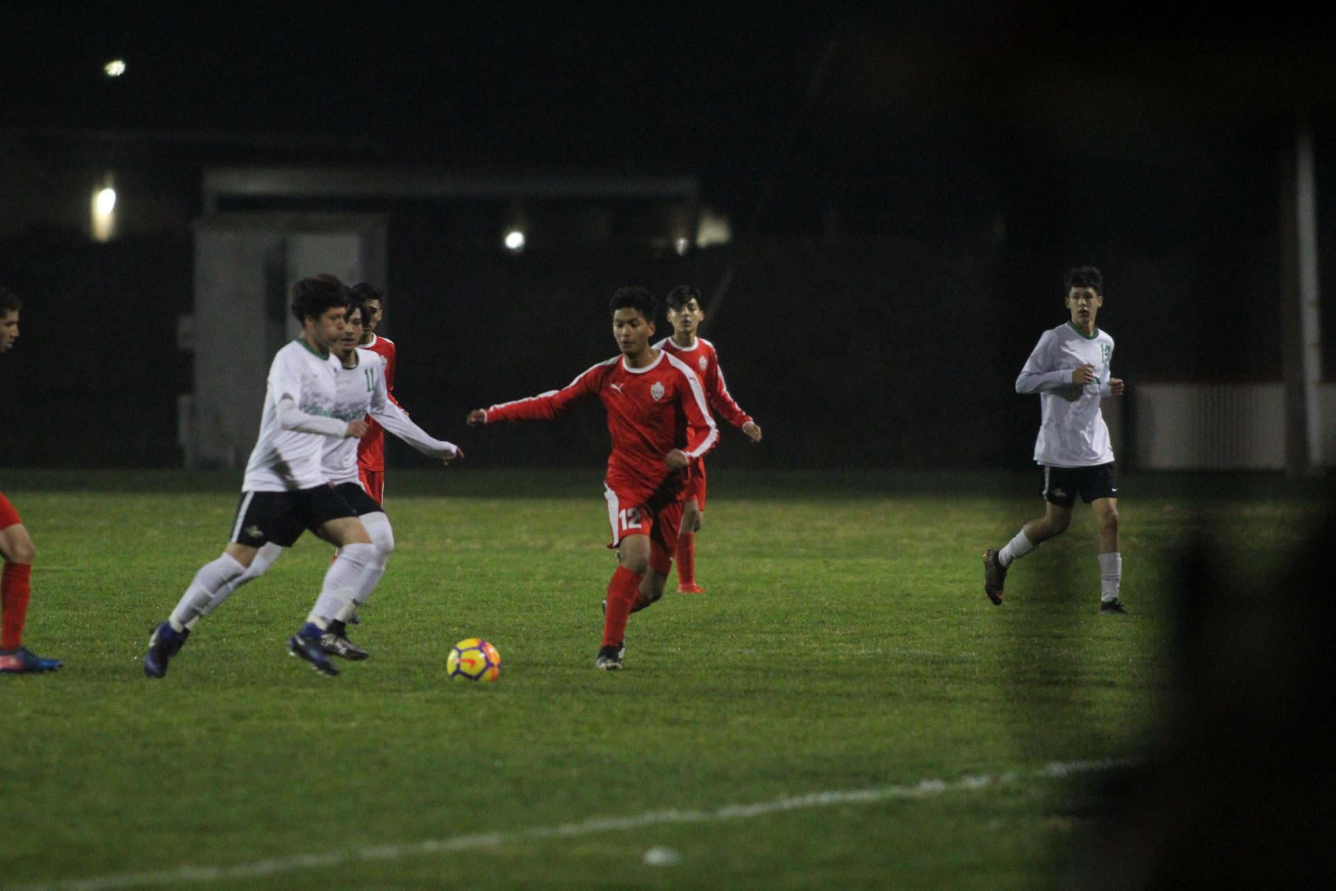 Boy's playing soccer Vs Roosevelt