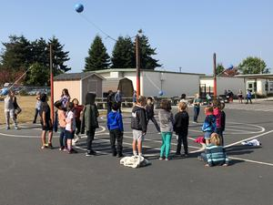 Crowd playing tetherball