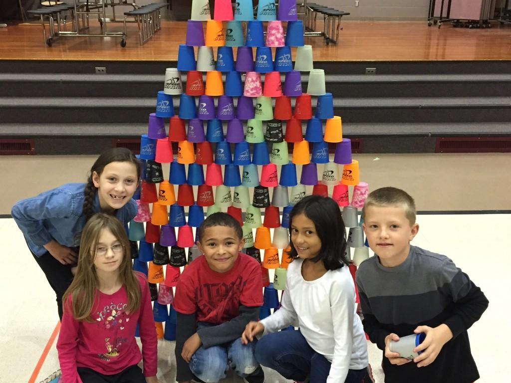 students compete to stack cups