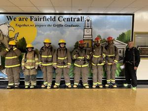 The firefighter students dressed in fire gear.