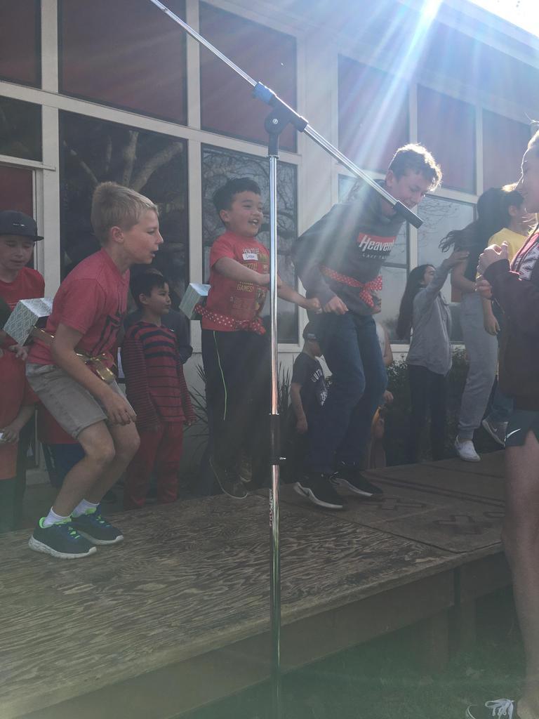students jumping at assembly