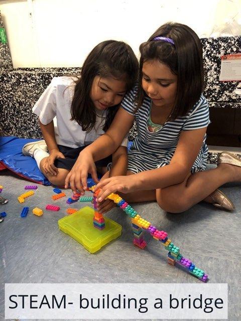 children building bridges with cubes
